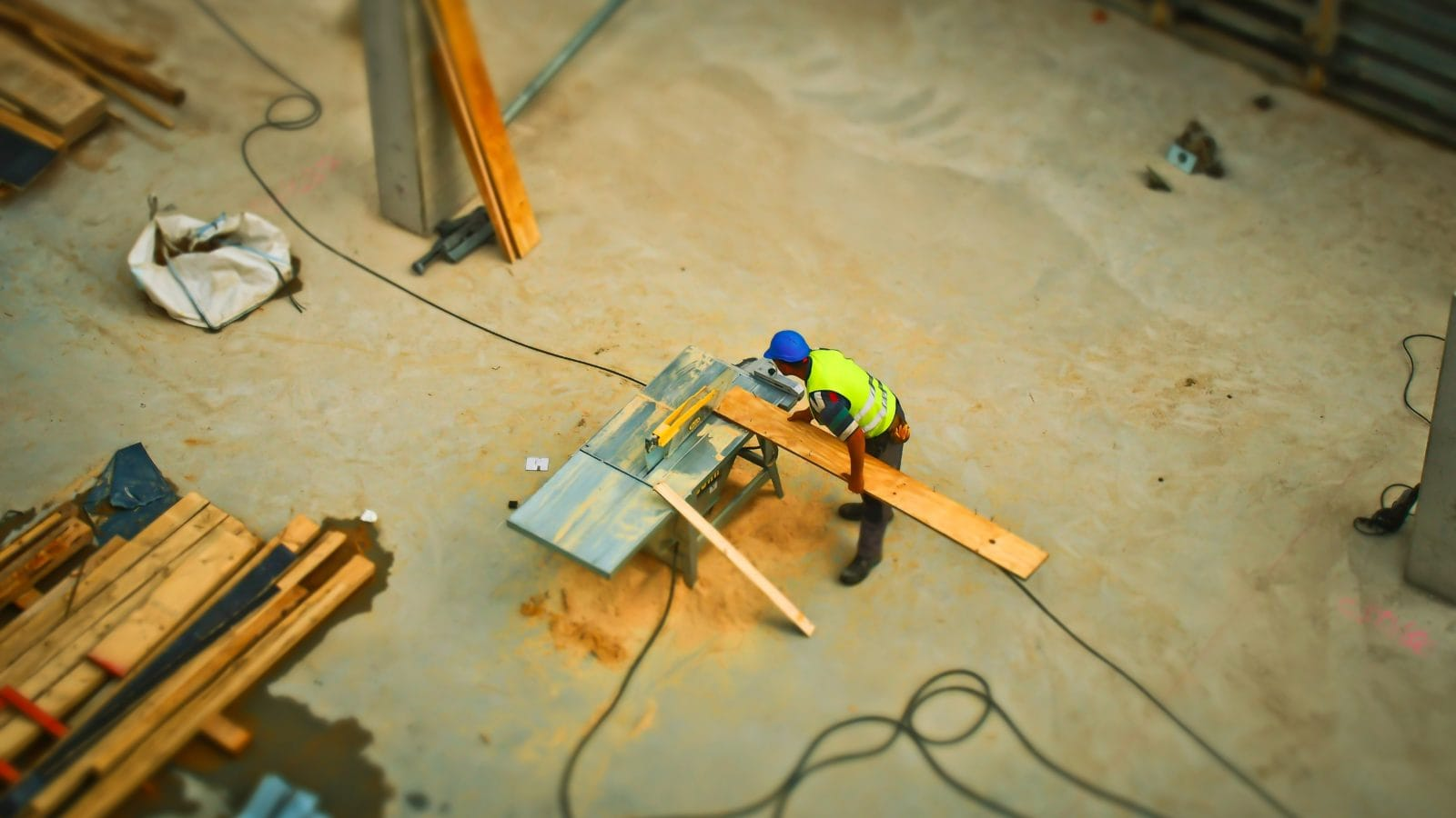Construction worker making cuts for an interior wall