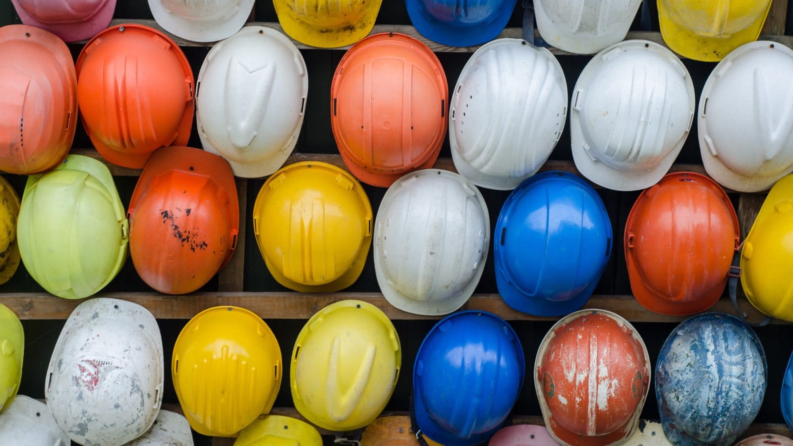 Different colored construction hard hats